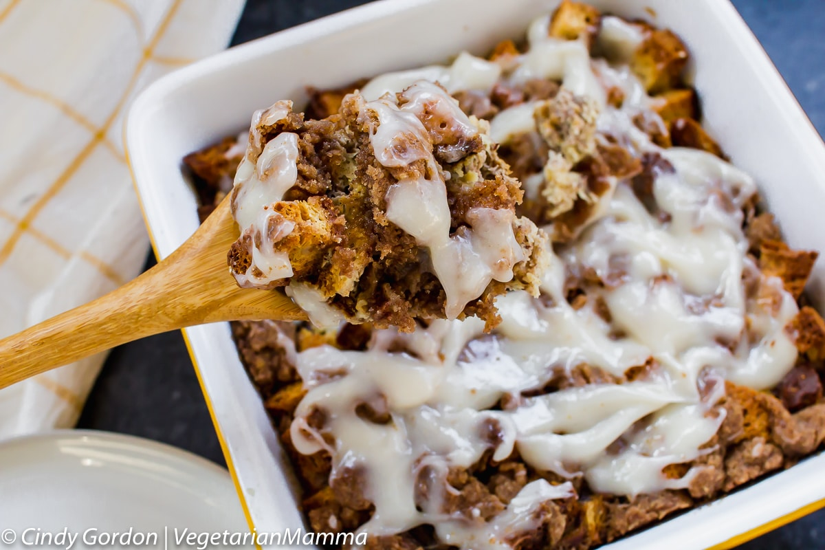 A spoon full of Cinnamon Roll French Toast Casserole