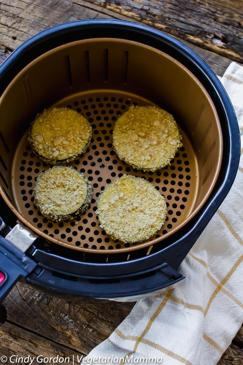 Breaded eggplant in an air fryer basket