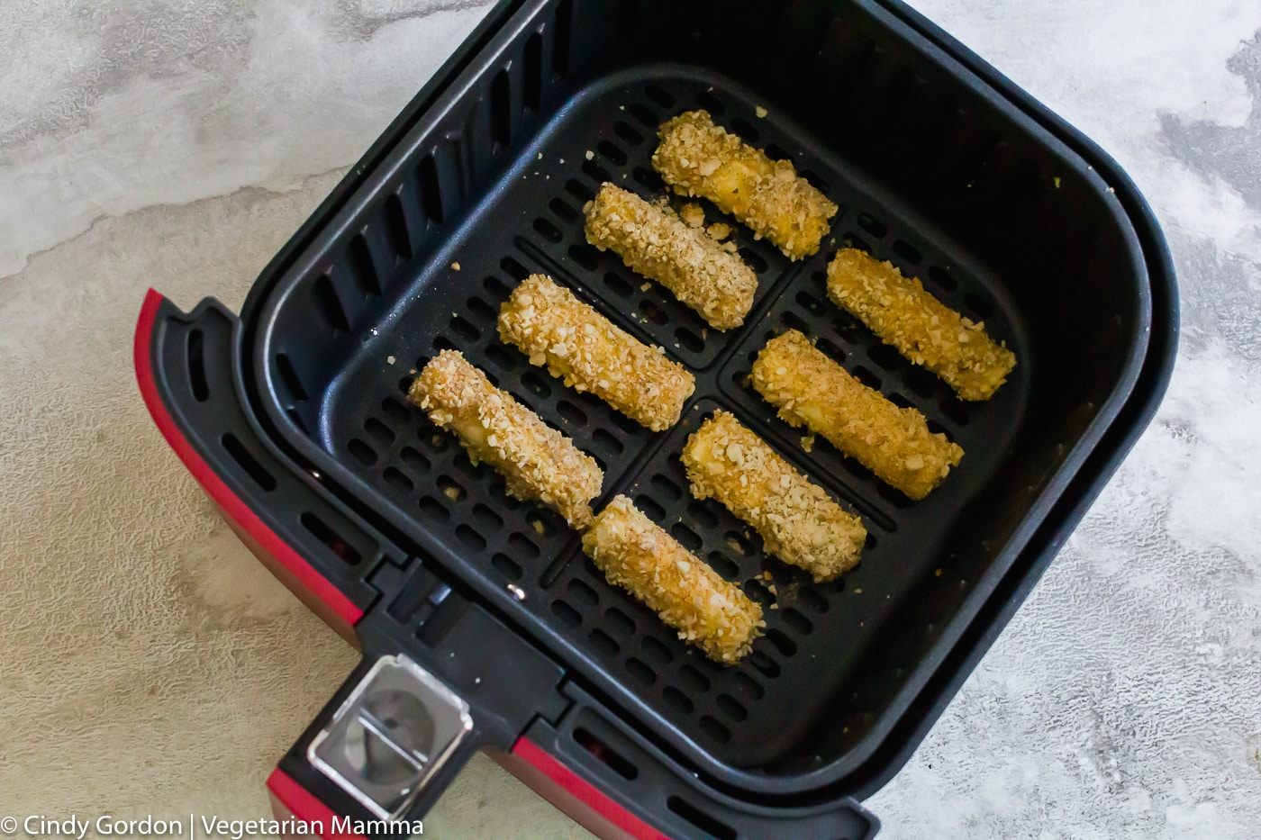 air fryer mozzarella sticks in the air fryer basket