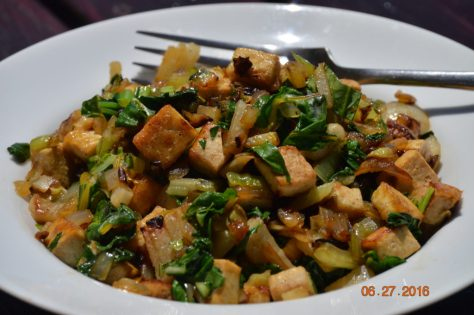Lots of delicious sauteed onions and Bok choy stems, sauteed tofu squares, Bok choy greens at the last minute and a bit of soy sauce. Mmmm...mmm...good!