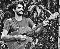 Paul Izak with guitar