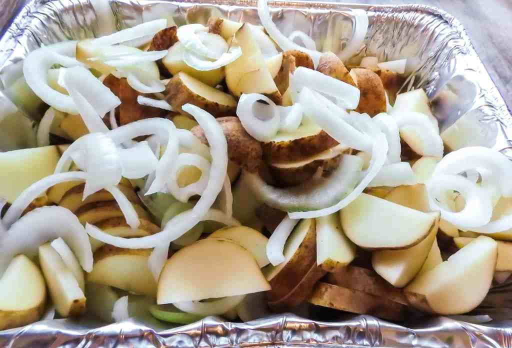 potatoes and onions in a foil pan