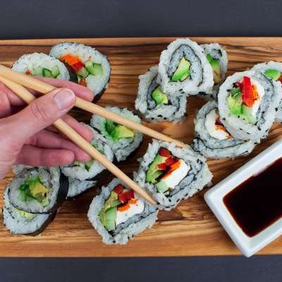 Vegan Sushi Rolls with Avocado, Carrot, Red Bell Pepper, Cucumber, and Vegan Cream Cheese