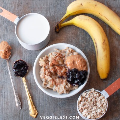 The Ultimate Creamy Oatmeal. Made with Soy Milk, Old Fashioned Oats, and Bananas. Topped with Peanut Butter and Jam. - by Veggie Lexi
