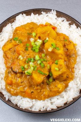 Try this delicious, easy, hearty, one pot coconut curry red lentil stew. It's loaded with sweet potatoes, onion, garlic, ginger, and carrots. Perfect on its own and pairs so well with rice, too. #veggielexi #veganrecipes #vegansoup #glutenfreerecipes - by Veggie Lexi