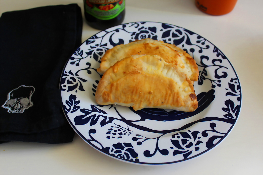 Spicy Vegetarian Empanadas are by far the best portable snack food in creation (in my not so humble opinion). Warm, golden crust enveloping a succulent blend of veggies and herbs.