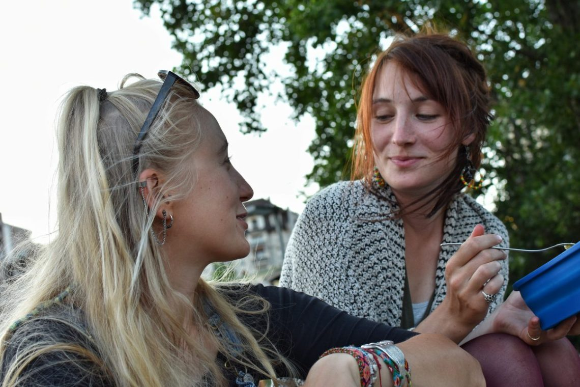 Two beautiful women chatting and laughing