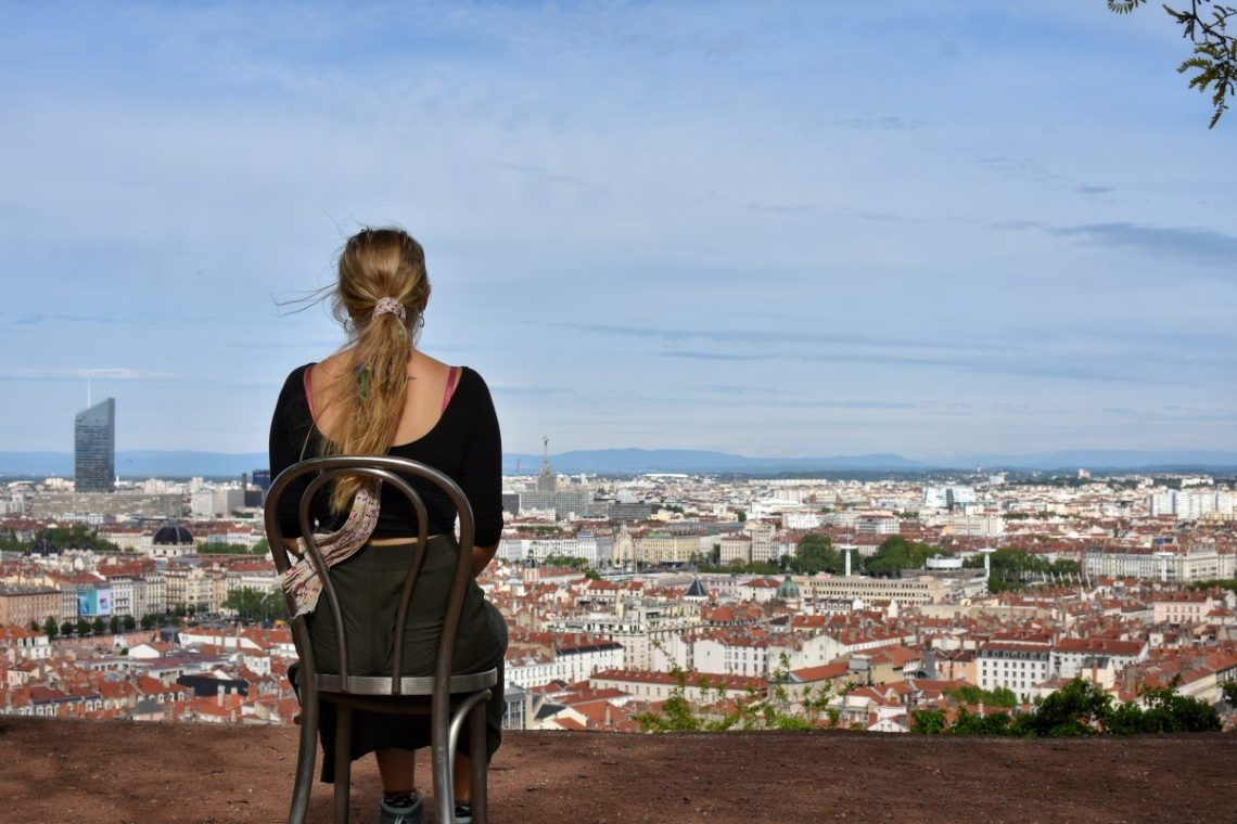 Girl sitting on chair overlooking Lyon