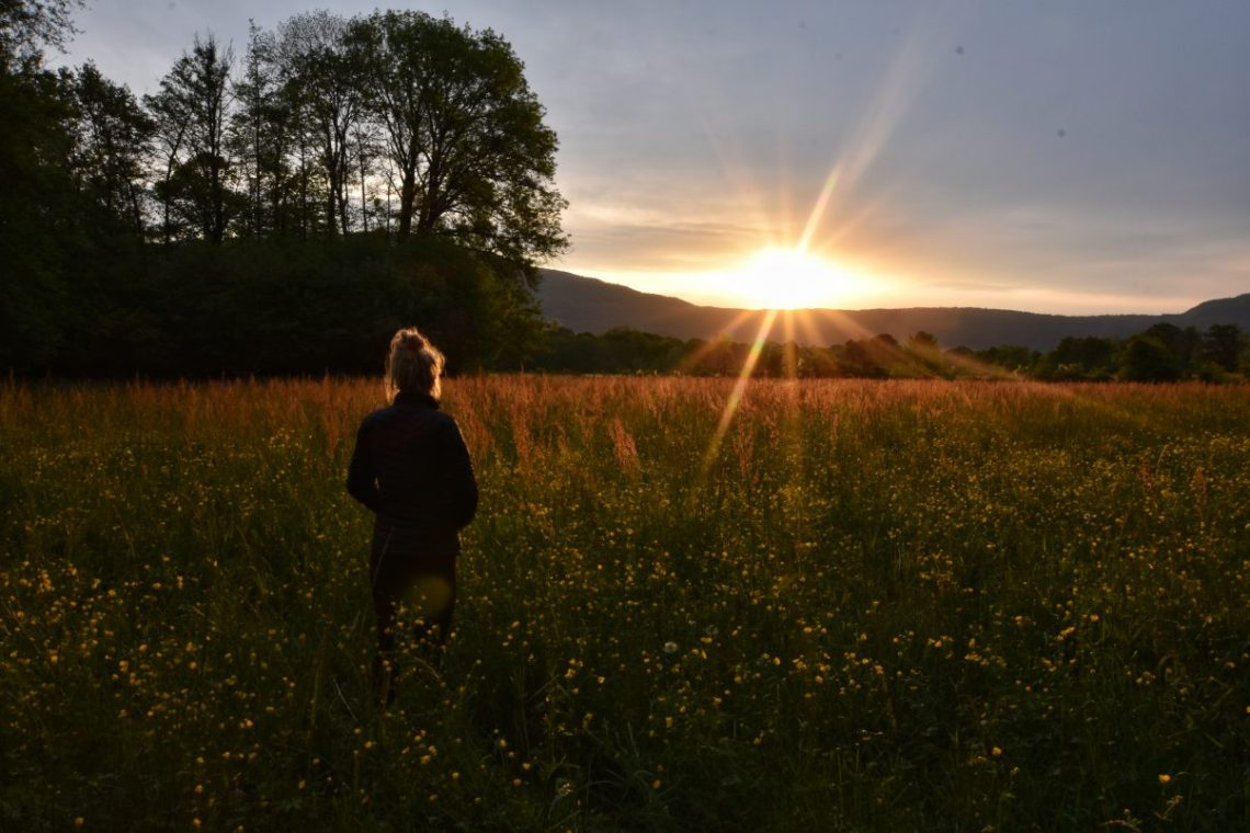 Girl in field sunrise