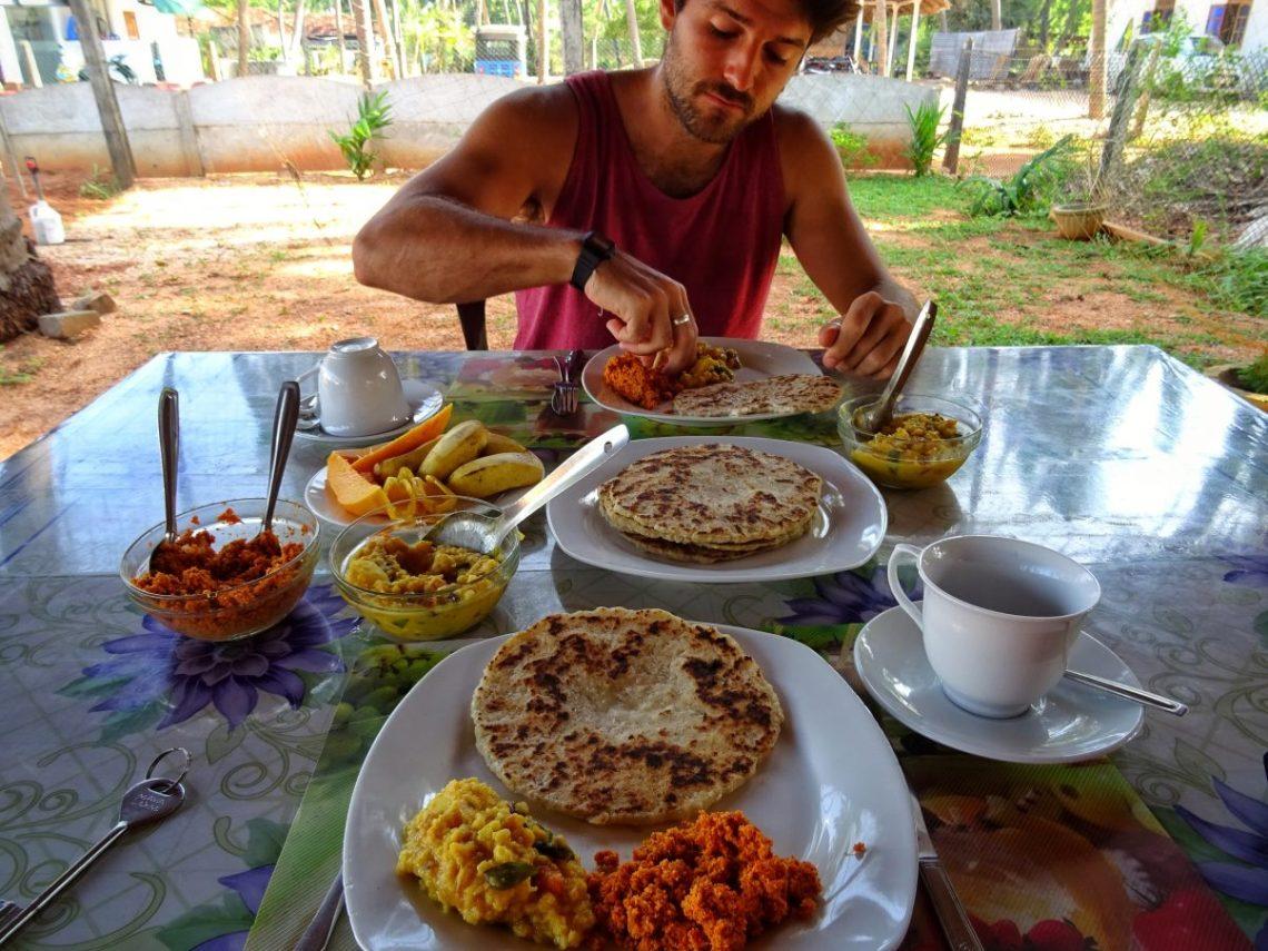 Man eating curry breakfast in Sri Lanka