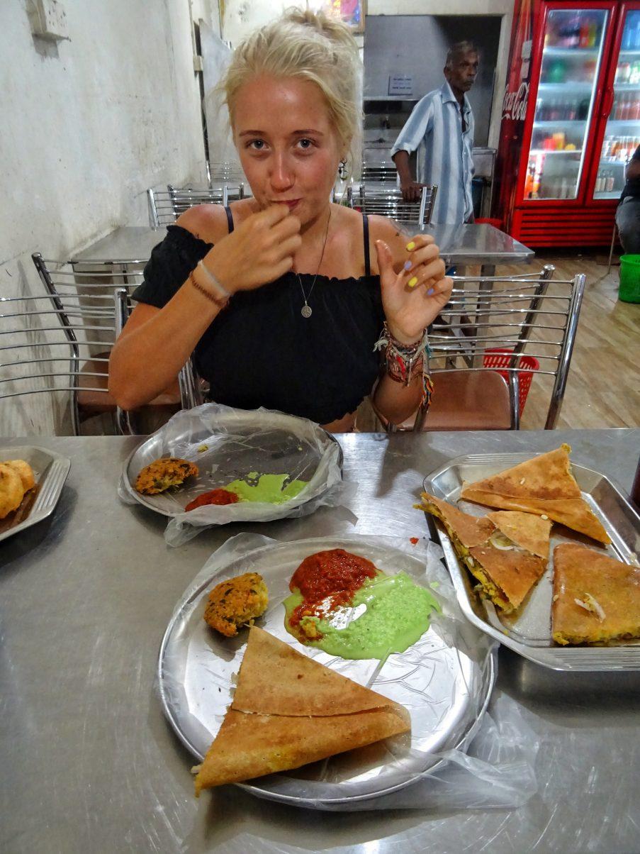 Girl eating curry in Sri Lanka
