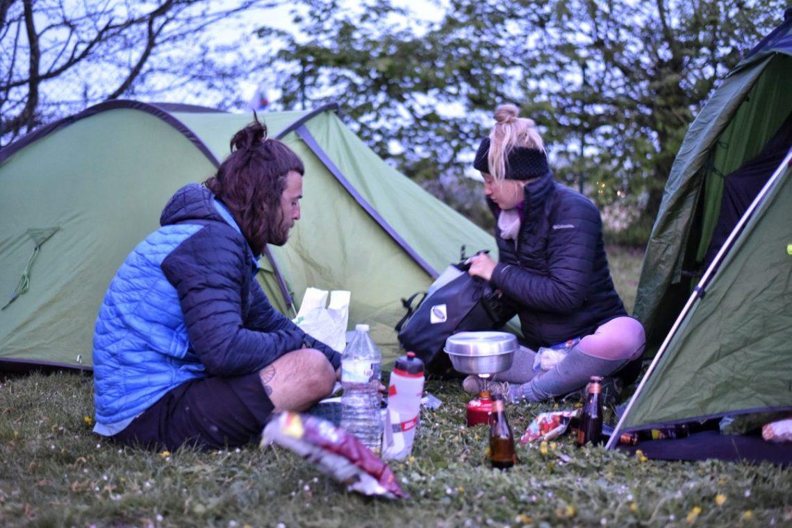 Couple eating vegan hiking food