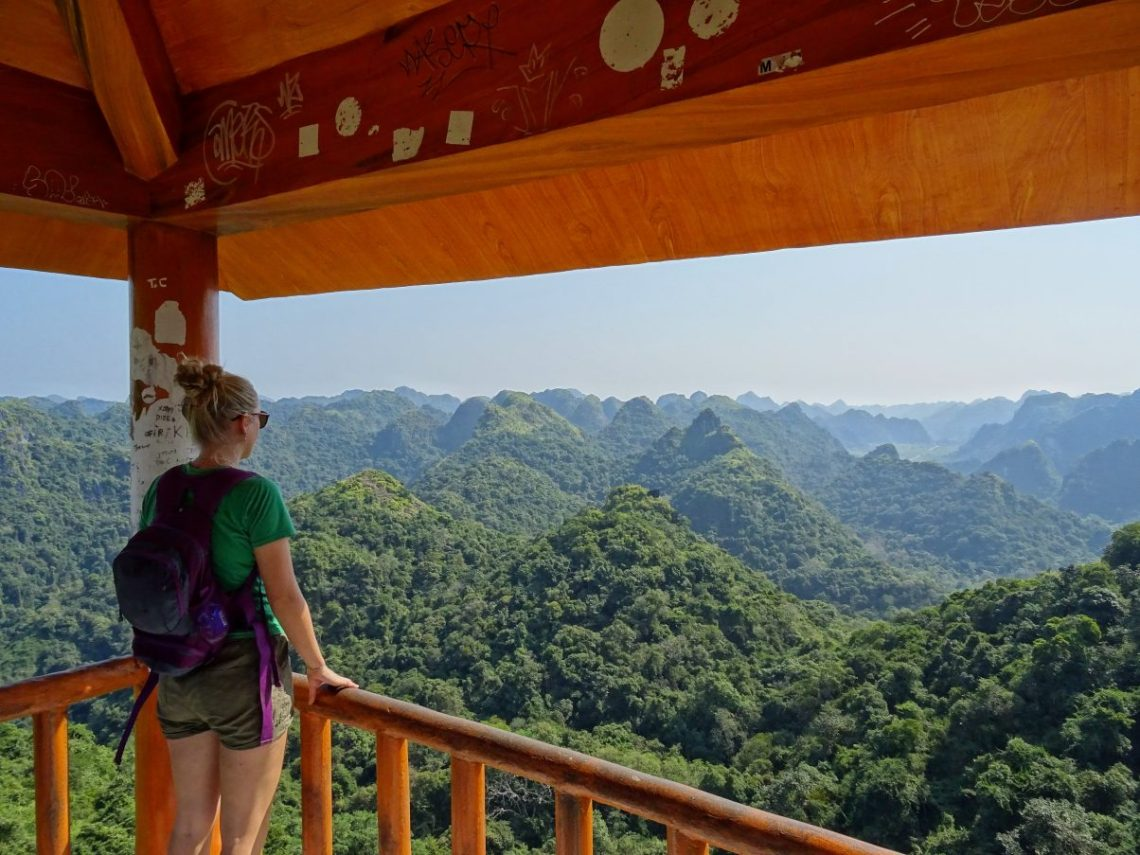 Girl overlooking mountains Cat Ba National Park