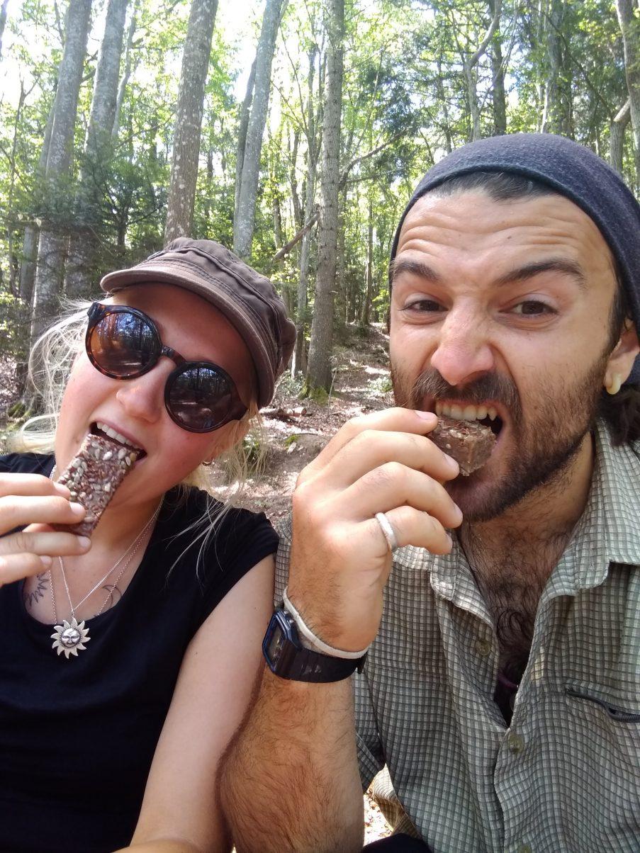 Two hikers having hiking snacks