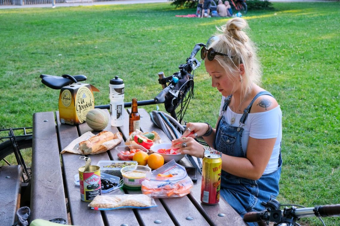 Girl eating food in park