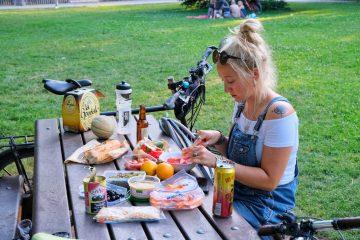 Girl eating food in park