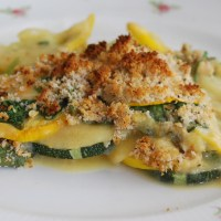 "Courgette and Spinach Gratin with a Creamy Vegan ""Cheese"" Sauce."