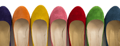 A row of different coloured leather shoes