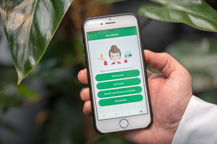 En smartphone visar en app om att panta