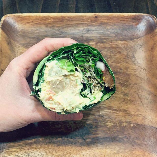 1/2 tofu dill, 1/2 unchicken tempeh in a collard green wrap