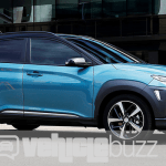 photograph of blue 2018 Hyundai Kona on the road.