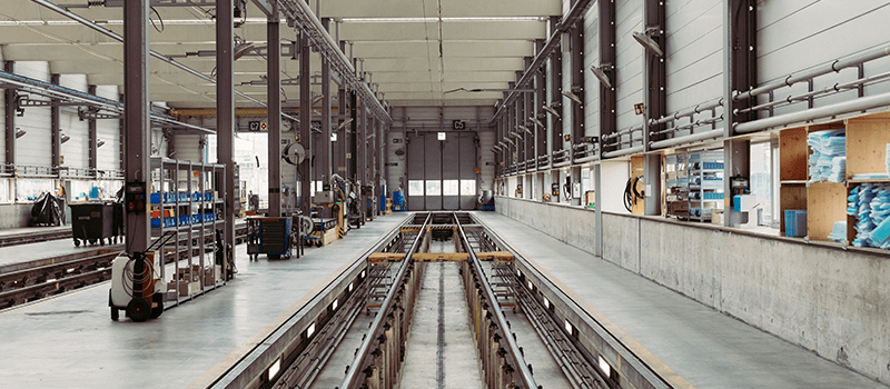 Image of an empty floor in an automotive factory.