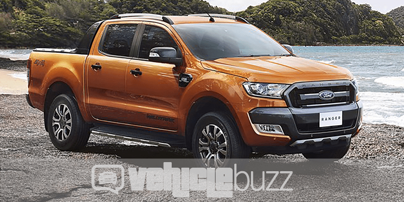 Photo of orange 2019 Ford Ranger from the side.