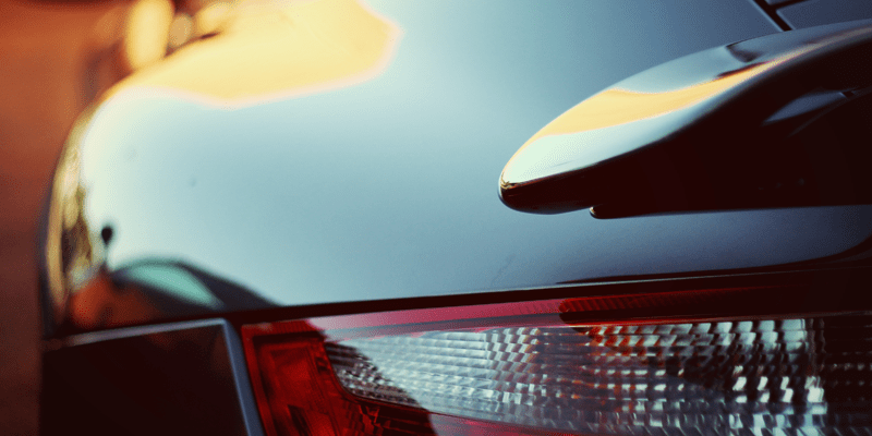 Stylized photo of rear brake light of a sports car.