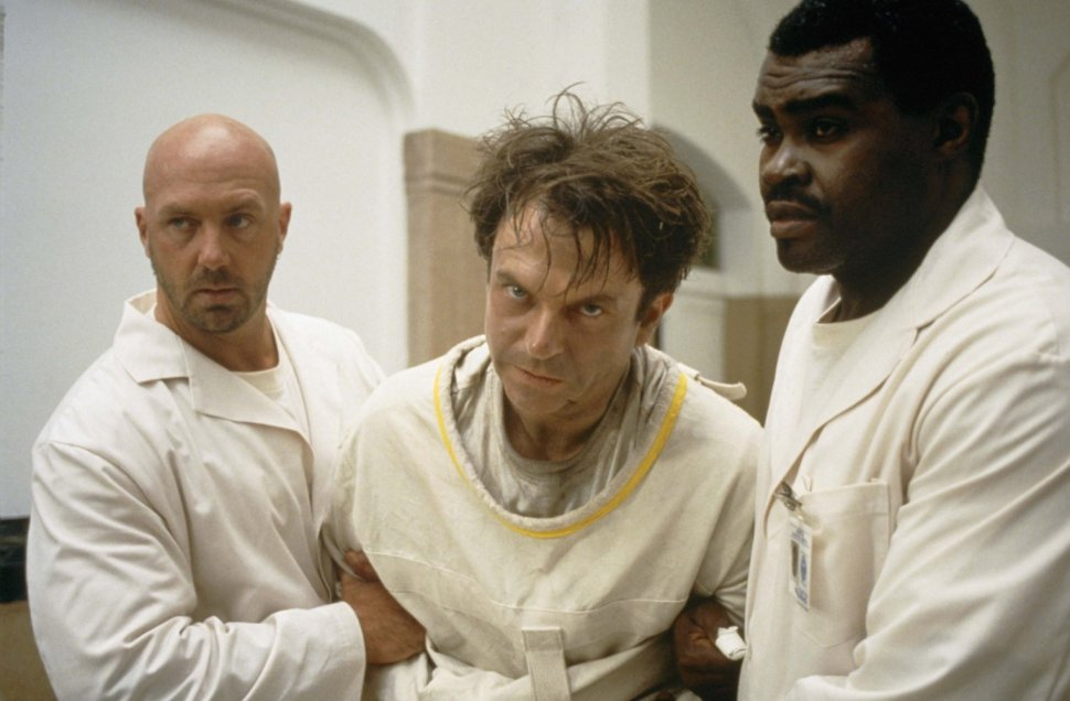 Sam Neill (center), Gene Mack, and Kevin Rushton in 'In the Mouth of Madness' (1994). Photo Credit: New Line Cinema.