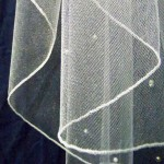 Pencil edge veil has a narrow stitched edge