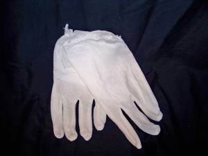 cotton gloves keep acids from hands off the dress