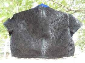 Back view of black lace bolero