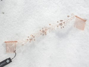 Full view rose gold hair vine on snow