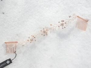 Full view rose gold hair vine on snow