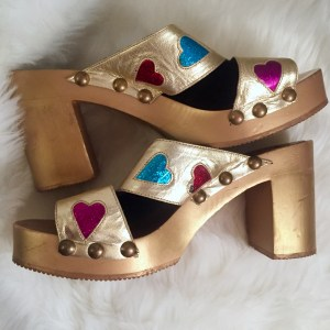 Miu Miu Candies platform clog heels wrapped in gold  foil and vivid iridescent hearts