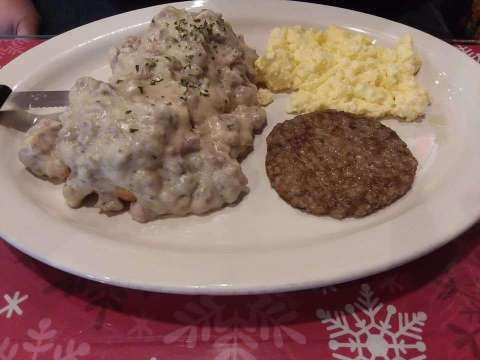 biscuits and gravy with sausage and scrambled eggs at le petit jardin venice florida