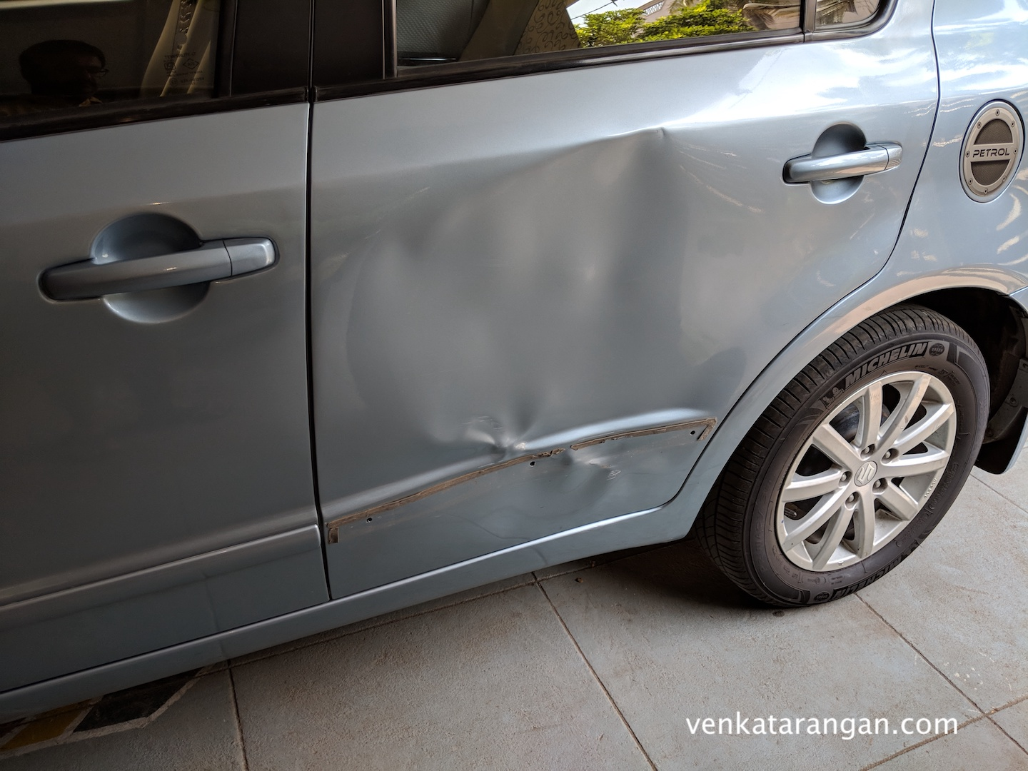 Car door that was damaged while left with valet parking