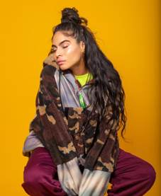 "WATCH: Jessie Reyez opens up about her debut album ""Before Love Came To Kill Us"" and collaborating with Eminem"