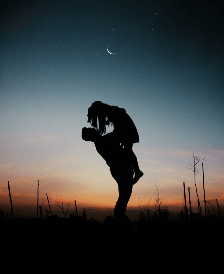 A silhouette of a couple at night