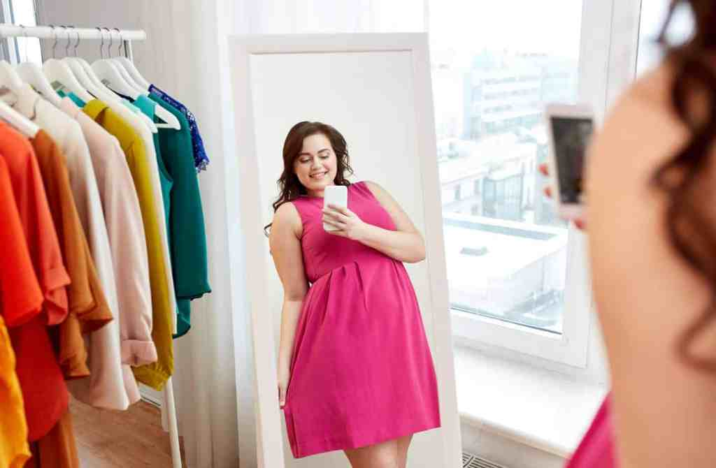 A plus-sized woman in a pink dress