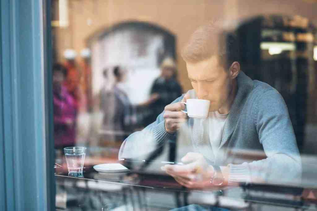 A man drinking coffee