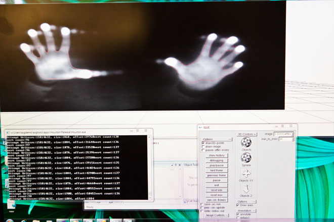 display-based sensor at Microsoft shows two hands approaching the screen
