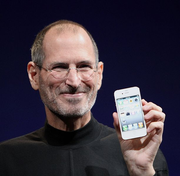 Steve Jobs holding an iPHone
