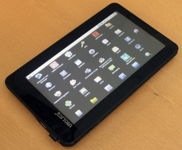 Aakash Android tablet photo, showing startup screen with icons
