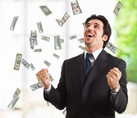 Man standing with cash raining