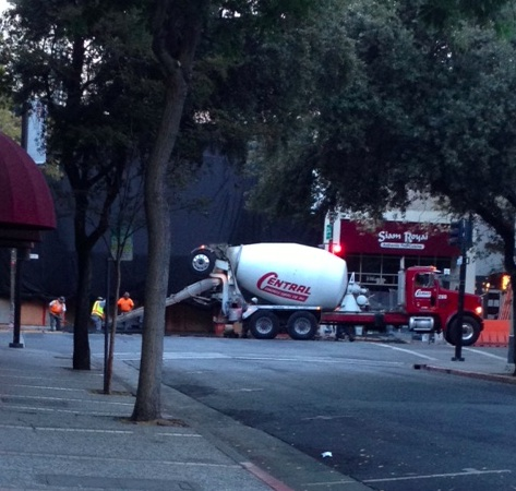 Workers pouring concrete at 7am Saturday outside what is likely Apple's next Palo Alto store