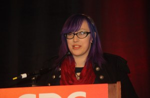 Zoe Quinn speaks about harassment at the Game Developers 2015 event.