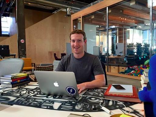 Facebook CEO Mark Zuckerberg at his computer.