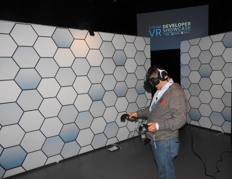 Dean Takahashi uses the hand controllers for the HTC Vive VR headset.
