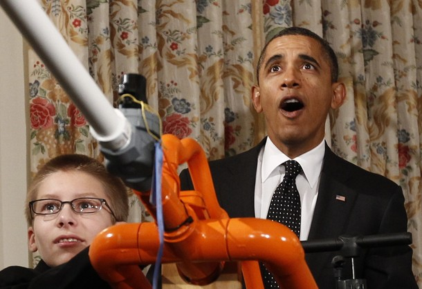 U.S. President Barack Obama reacts as Joey Hudy of Phoenix, Arizona launches a marshmallow from his Extreme Marshmallow Cannon in the State Dining Room of the White House during the second White House Science Fair .